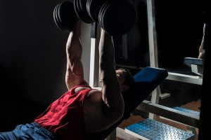 Man exercising using heavy dumbells