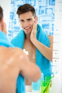 Man applying skin care routine