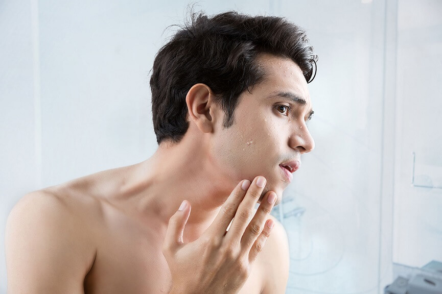 Man checking his face