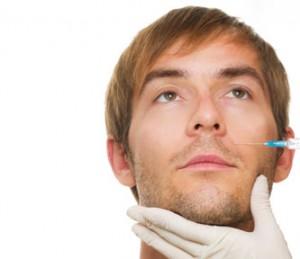 Man having needle treatment